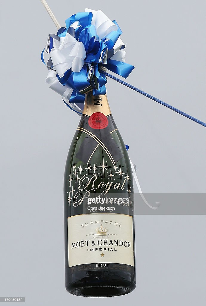 A bottle of Moet & Chandon Brut Imperial Champagne is readied with a bow prior to the arrival of Catherine, Duchess of Cambridge for the Princess Cruises ship naming ceremony at Ocean Terminal on June 13, 2013 in Southampton, England.