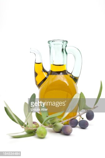 bottle of olive oil with olive twig