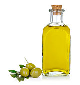 Bottle of olive oil with olives on white background.