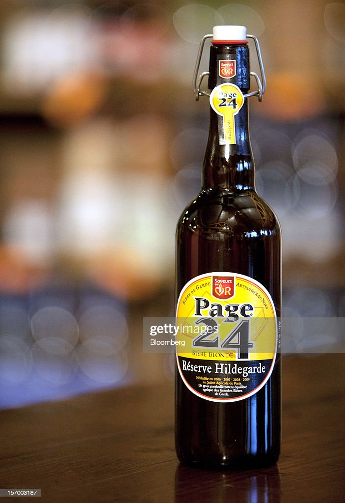 A bottle of Page 24 'Blonde Reserve Hildegarde' beer, produced by the brewer Brasserie Saint Germain, is seen displayed in the brewery store in Aix-Noulette, in France, on Monday, Nov. 26, 2012. Producers of beer in France, for instance, say any development plans they had have been 'nipped in the bud' by Hollande's plan to boost the tax on the drink next year. Photographer: Balint Porneczi/Bloomberg via Getty Images