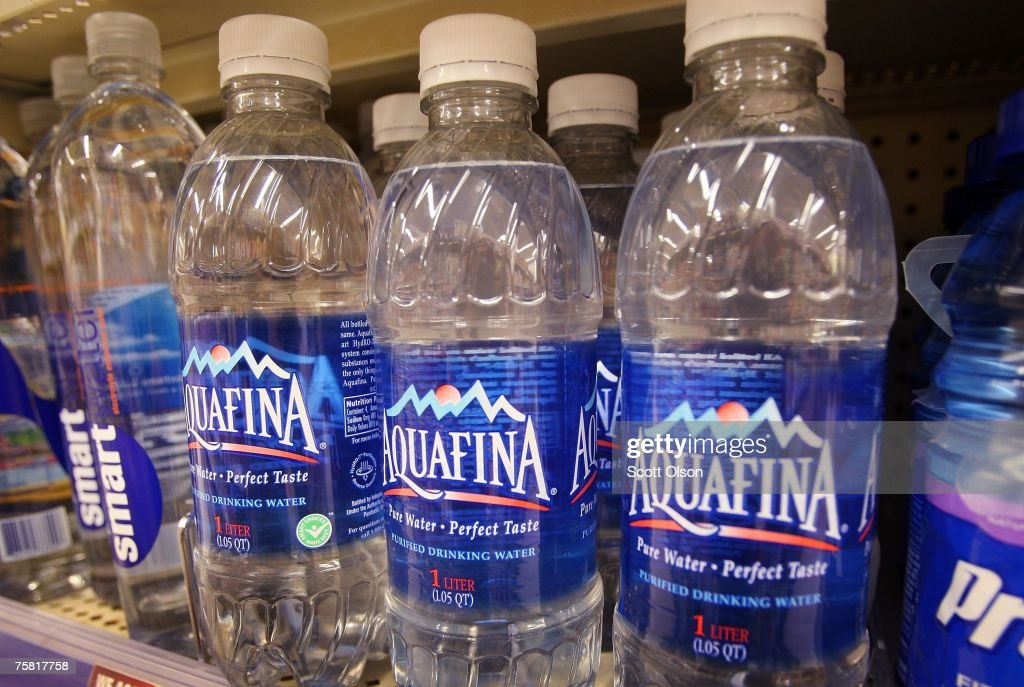 Bottle of Pepsi's Aquafina water sits on a shelf next to other brands of bottled water at a Walgreens store July 27 2007 in Chicago Illinois Pepsi...