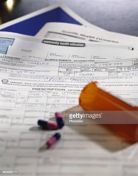 Bottle of Pills and Insurance Forms