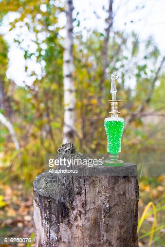 bottle of poison, poisonous capsule, halloween : Stock Photo