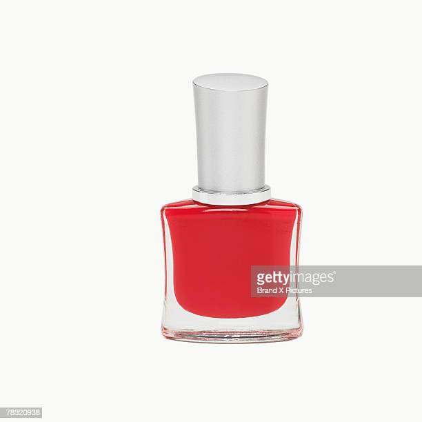 Bottle of red nail polish