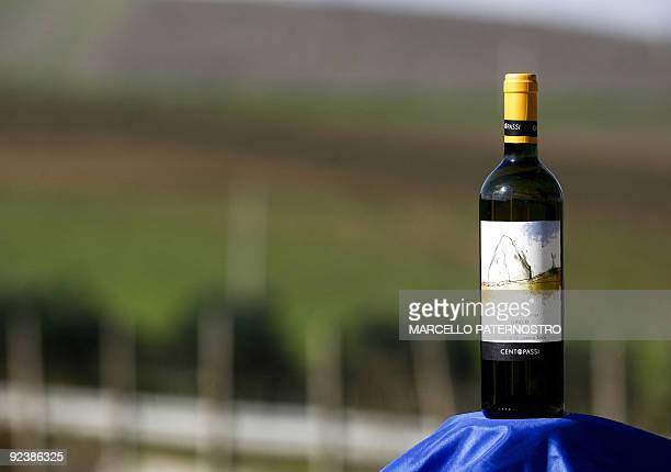 A bottle of red wine is pictured in San Cipirello on October 27 2009 during the official opening of the wine factory 'Centopassi ' Libera an Italian...