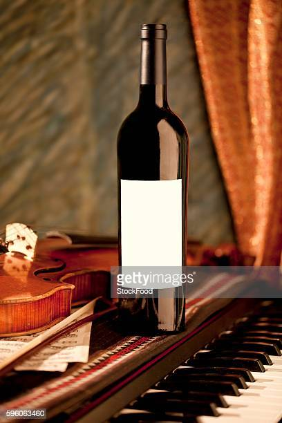 Bottle of Red Wine on a Piano; Violin