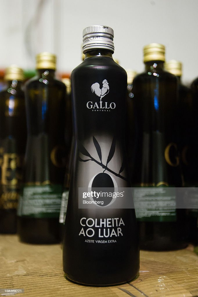 A bottle of special grade 'Colheita Ao Luar' olive oil stands at the Gallo Worldwide plant in Abrantes, Portugal, on Friday, Dec. 14, 2012. The Iberian nation has already been granted more time to narrow its budget shortfall after tax increases failed to bring in enough money to meet forecasts as the economy heads for a third year of contraction in 2013. Photographer: Mario Proenca/Bloomberg via Getty Images