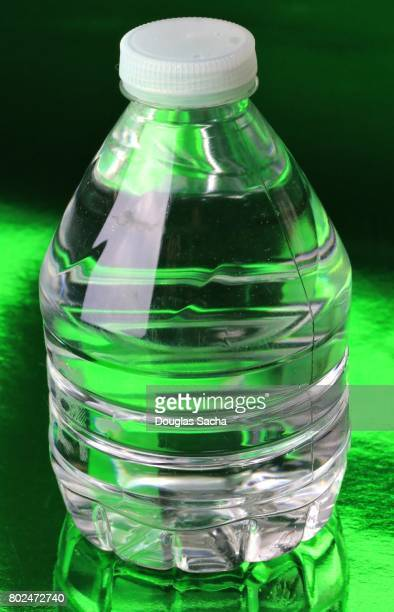 Bottle of Spring Water on a green background