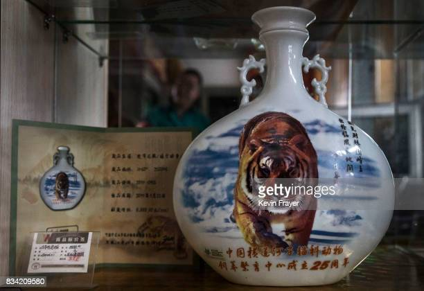 A bottle of 'tiger wine' is seen for sale at the Heilongjiang Siberian Tiger Park on July 5 2017 in Harbin northern China The center is one of two...