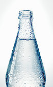 Bottle of water against white background, close-up