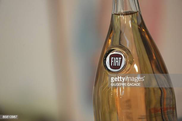 A bottle of wine bearing the logo of Italian car manufacturer Fiat is displayed on the second day of the Vinitaly wine exhibition in Verona on April...