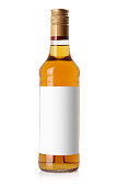 bottle with a light alcohol, golden liquor isolated on white