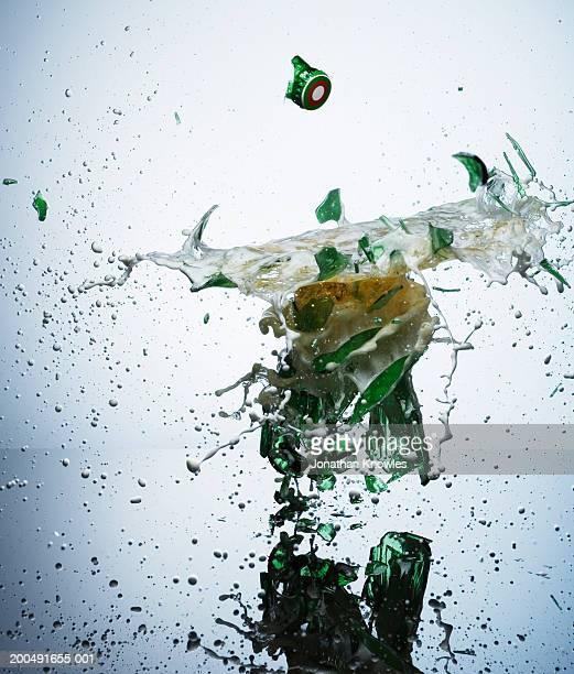 Bottled beer smashing on impact, close-up
