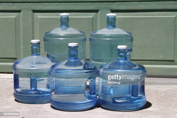 Bottled drinking water in five and three gallon jugs.