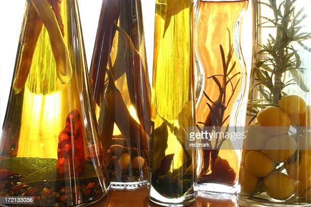 bottled herbs in olive oil -- backlit