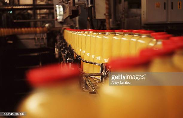 Bottled orange juice on moving production line