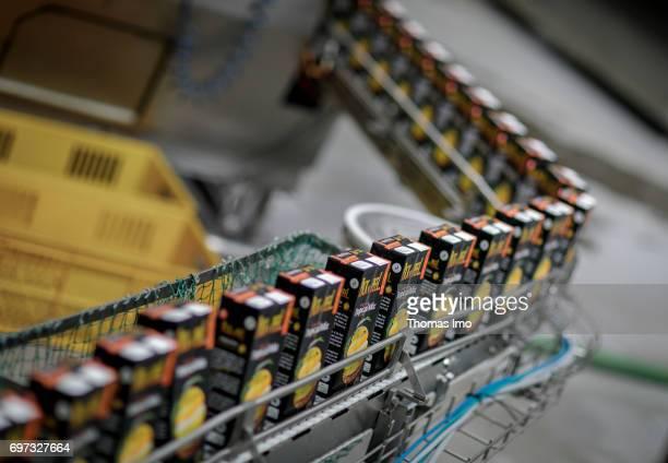 Bottled Tetra Paks with pineapple juice are transported over a conveyor belt Production of pineapple juice at beverages manufacturer Kevian Kenya Ltd...