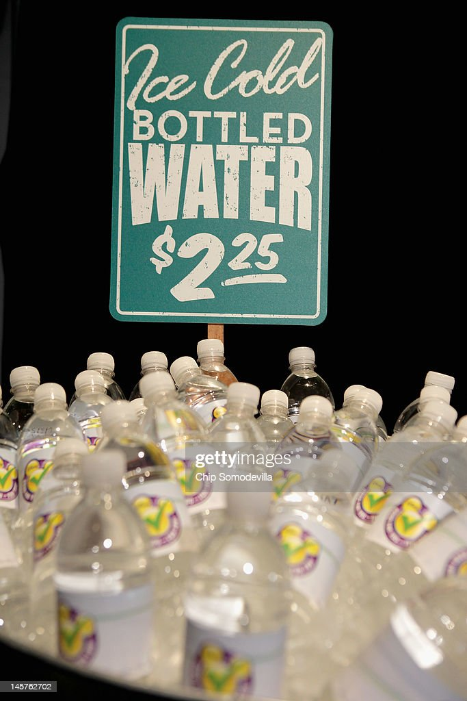 Bottled water is displayed during an event introducing The Walt Disney Companys new 'Magic of Healty Living' program at the Newseum June 5, 2012 in Washington, DC. As part of the new healthy eating initiative, all products advertised on Disney's child-focused television channels, radio stations and Web sites must adhear to a new set of strict nutritional standards. Addionally, Disney-licensed products that meet criteria for limited calories, saturated fat, sodium and sugar can display a logo - Mickey Mouse ears and a check mark - on their packaging.