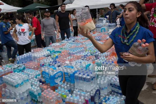 Bottled water is distributed at Parque Mexico in the Condesa district the day after an earthquake on September 20 2017 in Mexico City Mexico...