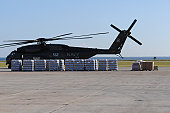 Guantanamo Bay, Cuba, January 17, 2010 - Bottled water is ready to be loaded onto a U.S. Navy MH-53E Sea Dragon helicopter at Naval Station Guantanamo Bay as part of Operation Unified Response Haiti r
