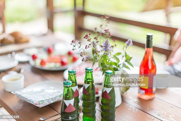 Bottled water, wine and food on patio table
