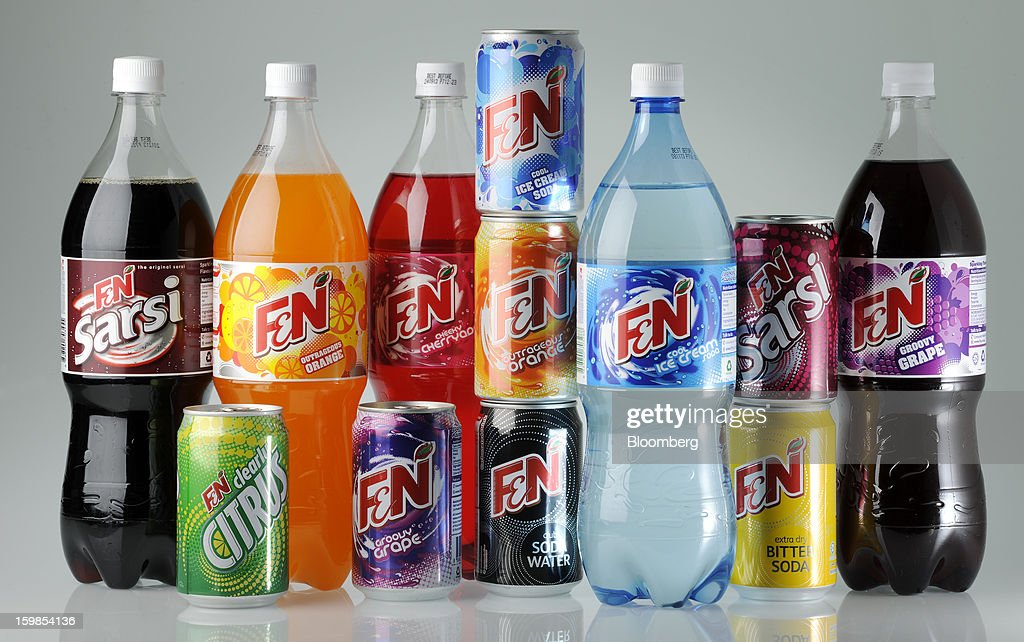 Bottles and cans of Fraser & Neave Ltd.'s F&N sparkling drink in various flavors are arranged for a photograph in Singapore, on Monday, Jan. 21, 2013. Thailand's richest man came closer to winning control of Fraser & Neave after a rival group failed to top his S$13.8 billion ($11.2 billion) offer for the 130-year-old property and beverage company. Photographer: Munshi Ahmed/Bloomberg via Getty Images