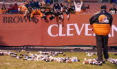 Bottles and debris litter the field at Cleveland Browns Stadium in Cleveland Ohio as frustrated Brown fans defy a referee's call during the Cleveland...