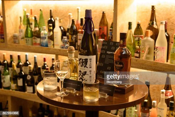 Bottles and glasses of liquor are displayed at the Amazon Bar operated by Amazon Japan KK during a media preview in Tokyo Japan on Thursday Oct 19...