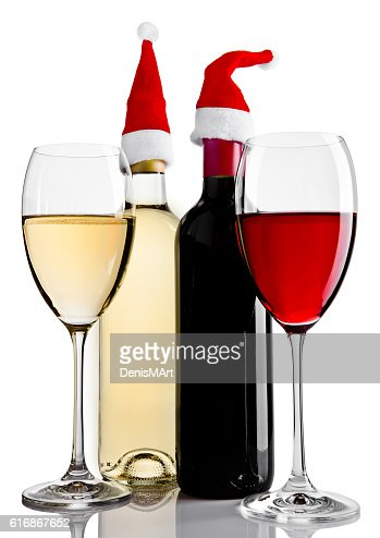 Bottles and glasses of red white wine santa hat : Stock Photo