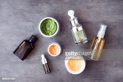 Bottles and jars with natural cosmetics : Stock Photo