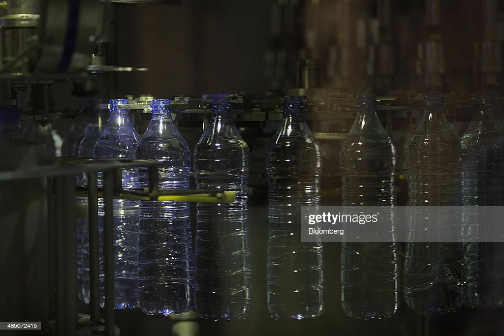 Bottles are filled with Kinley water at the Habib Gulzar Non-Alcoholic Beverage Ltd. bottling facility, a bottler for Coca-Cola Co., in Kabul, Afghanistan, on Thursday, April 10, 2014. Coca-Cola Co., the world's largest soda maker, today showed signs of a rebound in the first three months of the year, easing the concerns that arose when the company unsettled investors with surprisingly sluggish global sales in the fourth quarter. Photographer: Victor J. Blue/Bloomberg via Getty Images
