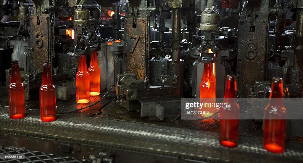 Bottles are seen on the production line of Phoenicia Glass Works Ltd factory on December 31, 2012 in the southern city of Yerukham south of Beer Sheva.