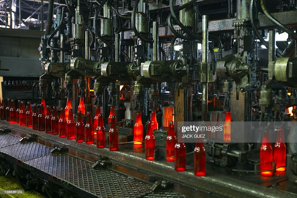 Bottles are seen on the production line of Phoenicia Glass Works Ltd factory on December 31, 2012 in the southern city of Yerukham south of Beer Sheva. AFP PHOTO / JACK GUEZ