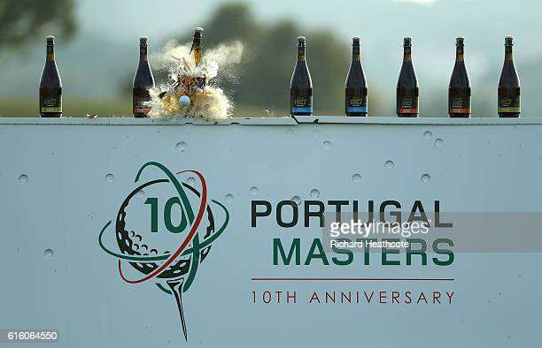 Bottles are smashed by Thomas Pieters and Andy Sullivan during a stunt to celebrate the 10th edition of the Portugal Masters at the Victoria Clube de...