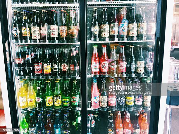 Bottles Arranged In Refrigerator At Store For Sale