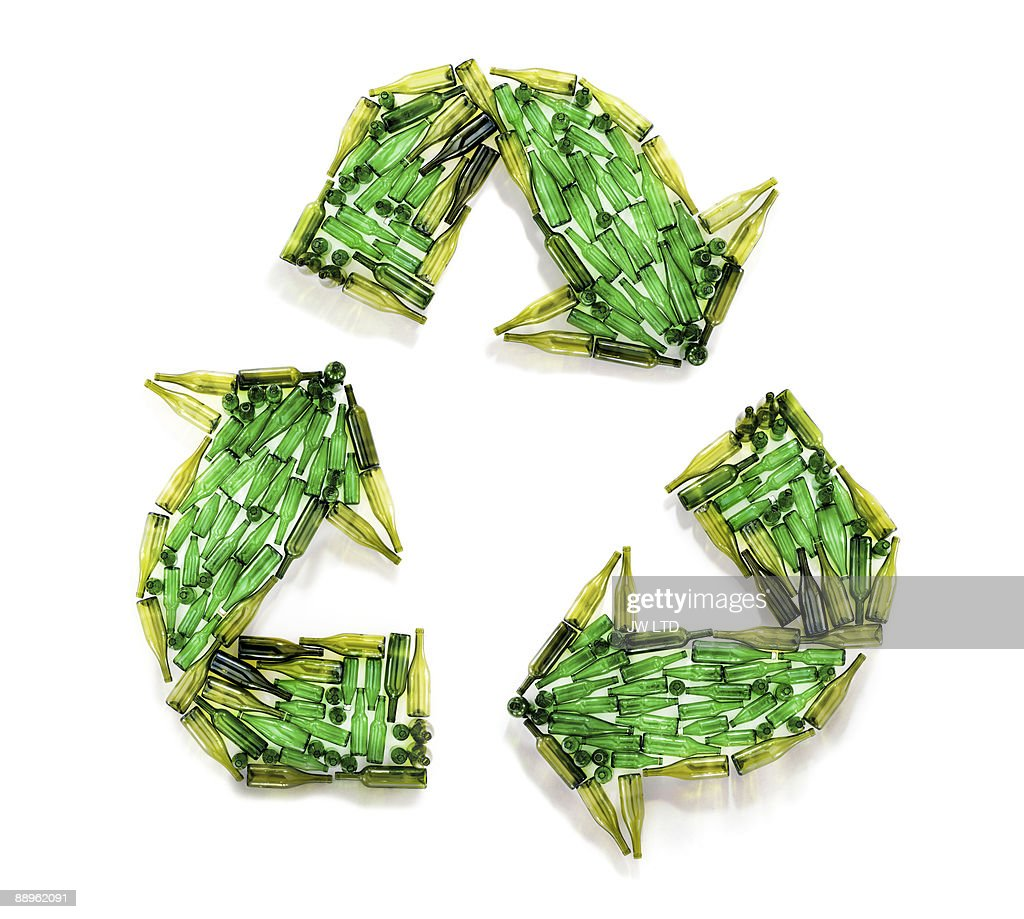 Bottles in shape of recycling symbol : Stock Photo