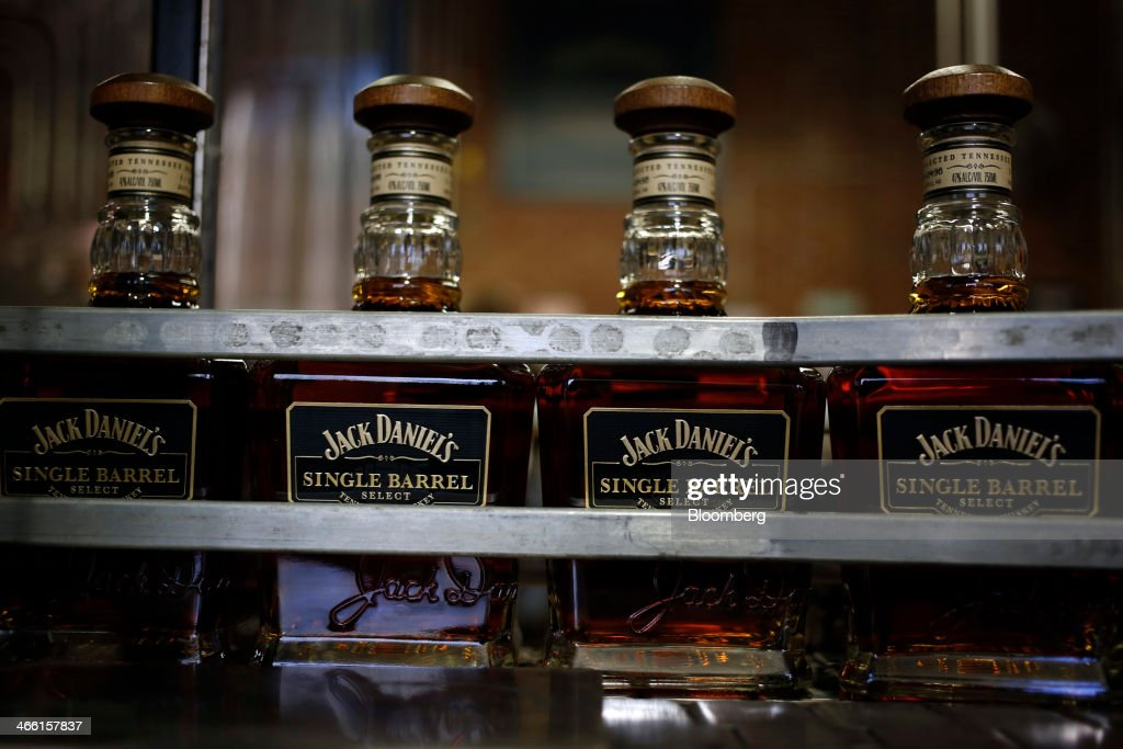 Bottles move down a conveyor belt on the Jack Daniel's Single Barrel Select Tennessee Whiskey bottling line at Jack Daniel's Distillery in Lynchburg, Tennessee, U.S., on Thursday, Jan. 30, 2014. Jack Daniel's is owned by Brown-Forman Corp., which announced a regular quarterly cash dividend of 29 cents per share on its Class A and Class B Common stock last week in a company press release. Photographer: Luke Sharrett/Bloomberg via Getty Images