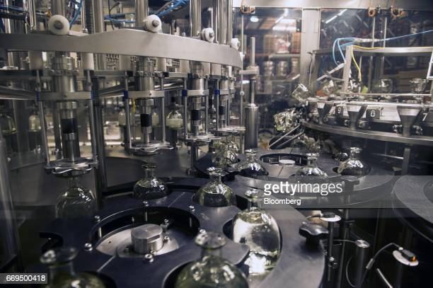 Bottles move through a filing machine at the Patron Spirits Co tequila distillery in Atotonilco El Alto Jalisco Mexico on Tuesday April 4 2017 The...