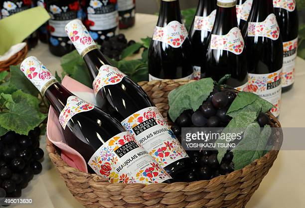Bottles of 2015 Beaujolais Nouveau wine are displayed shortly after their arrival at Tokyo's Haneda Airport on October 31 2015 The first cargo of...