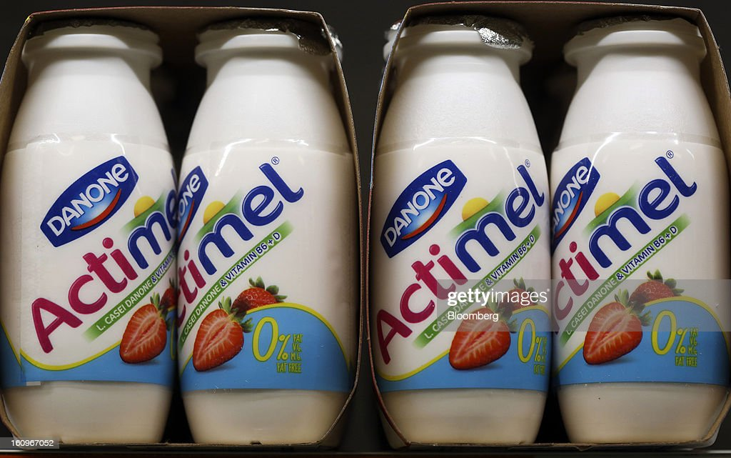 Bottles of Actimel yoghurt drinks, produced by Danone SA, sit on a shelf in the chilled section of a supermarket in London, U.K., on Friday, Feb. 8, 2013. Britain's economy will grow more slowly this year than previously forecast and stagnation may persist, according to the National Institute of Economic and Social Research. Photographer: Chris Ratcliffe/Bloomberg via Getty Images