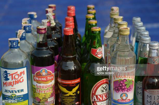 Bottles of alcohol set to be destroyed are displayed by police ahead of the holy month of Ramadan at a police station in Jakarta on June 15 2015...