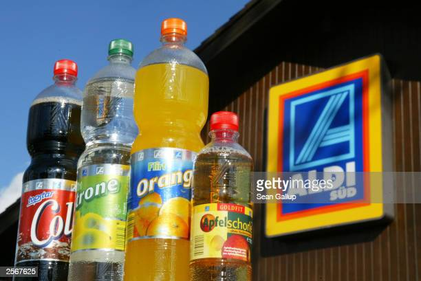 Bottles of Aldi ownbrand soft drinks are on display outside an Aldi discount grocery store October 6 2003 in Buchenau Germany New German laws that...
