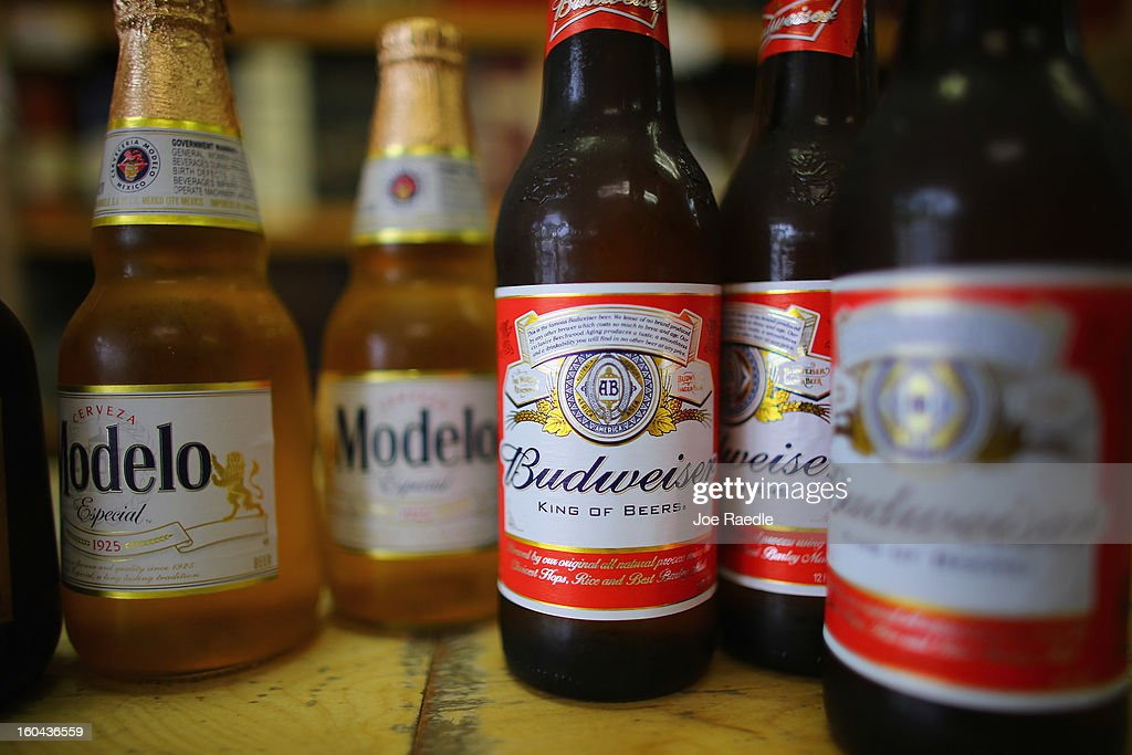 Bottles of Anheuser-Busch Budweiser and Grupo Modelo, Modelo beers are displayed at the Chandi Wine and spirits store on January 31, 2013 in Miami, Florida. Federal authorities filed a lawsuit January 31, to stop the Anheuser-Busch InBev's $20.1 billion takeover of Grupo Modelo.