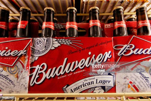 Bottles of AnheuserBusch's Budweiser beer are displayed in the cooler at Beverage World in the Brooklyn borough of New York US on Monday July 7 2008...