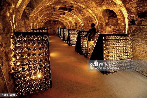 Bottles of 'Armand de Brignac' Champagne are seen in the cellars of the Cattier champagne family house on November 6 2014 in ChignylesRoses south of...