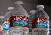 Bottles of Arrowhead water are displayed on a shelf at a convenience store on August 20 2014 in San Rafael California Despite the historic California...