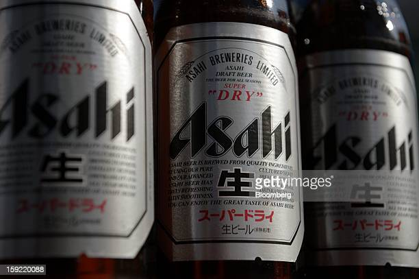 Bottles of Asahi Breweries Ltd Asahi Super Dry beer are arranged for a photograph in Kawasaki Kanagawa Prefecture Japan on Wednesday Jan 9 2013...