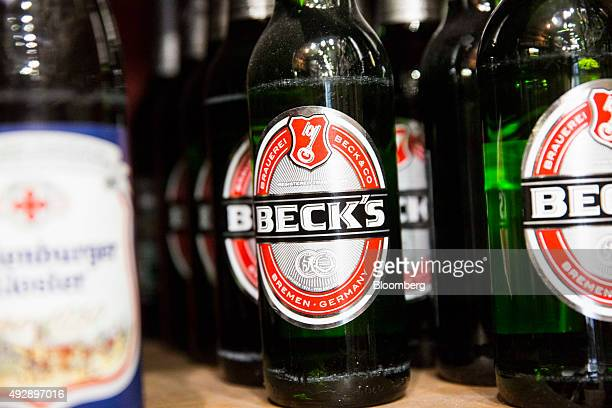 Bottles of Beck's beer produced by AnheuserBusch InBev NV sit on display in a store in Paris France on Thursday Oct 15 2015 AB Inbev is planning to...