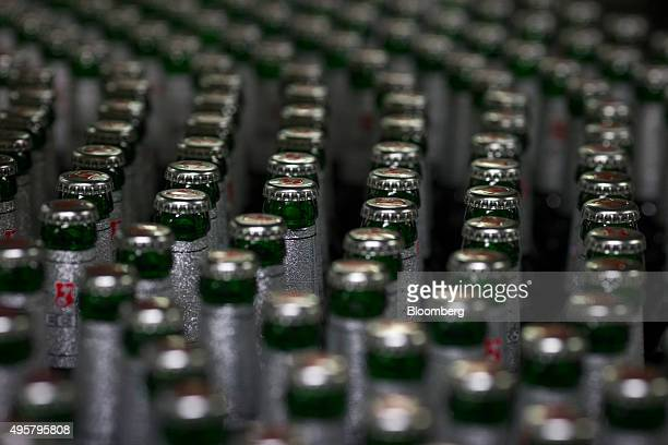 Bottles of Beck's lager beer move along the production line at the Beck's brewery operated by AnheuserBusch InBev NV in Bremen Germany on Wednesday...