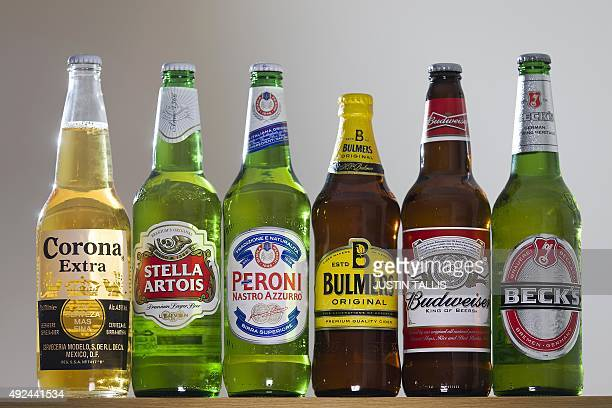 Bottles of beer and cider produced by BelgianBrazilian group AnheuserBusch InBev and British brewer SABMiller are pictured in London on October 13...